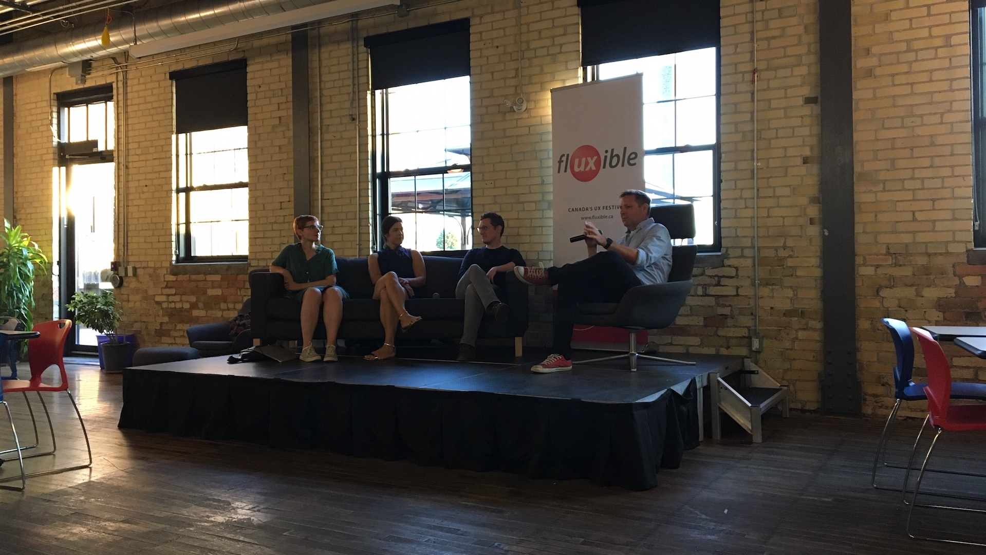 Janice de Jong (left), Davis Neable, Jeff Kraemer, and Jeff Fedor (right), address an audience at a UX career panel during Fluxible Meetup.